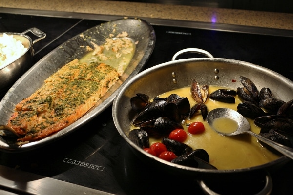 roasted salmon and steamed mussels on a buffet