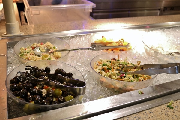 a variety of cold salads on a buffet