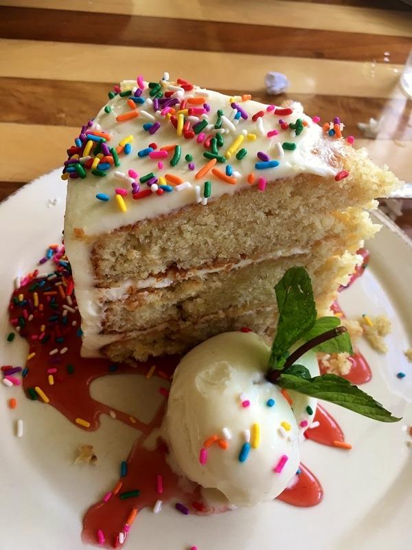 a slice of hummingbird cake with rainbow sprinkles