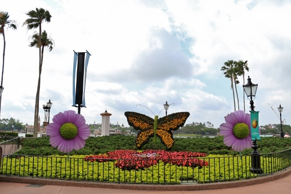 a topiary display of a butterfly and flowers