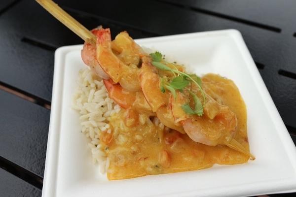 shrimp skewered on sugar cane, served over rice