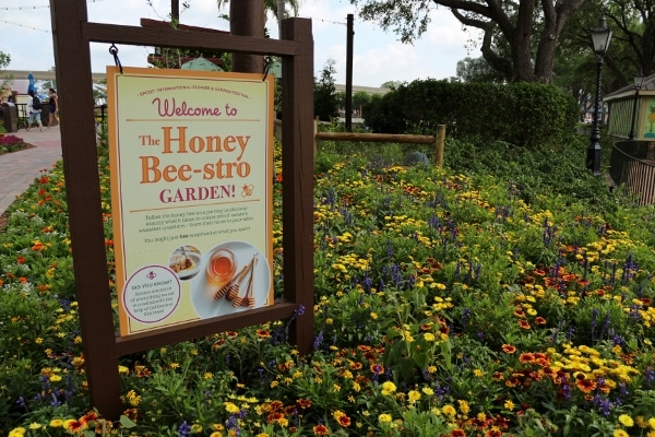A sign that says The Honey Bee-stro Garden