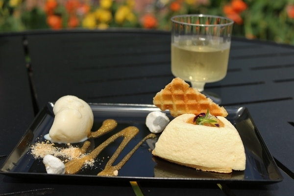 a plate of dessert with a glass of wine