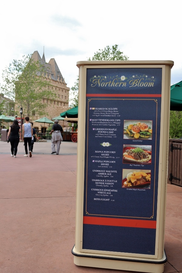 the Northern Bloom menu with the Epcot\'s Canada Pavilion in the distance