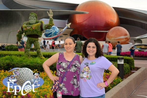 2 woman posing in front of Mission Space