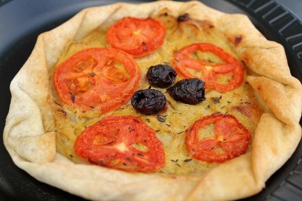 closeup of an onion and tomato tart