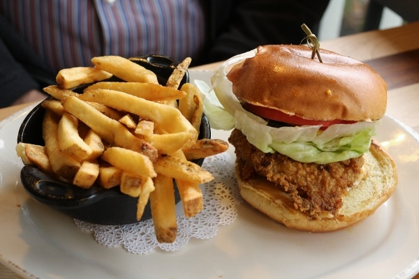 a fried chicken sandwich with fries on a plate