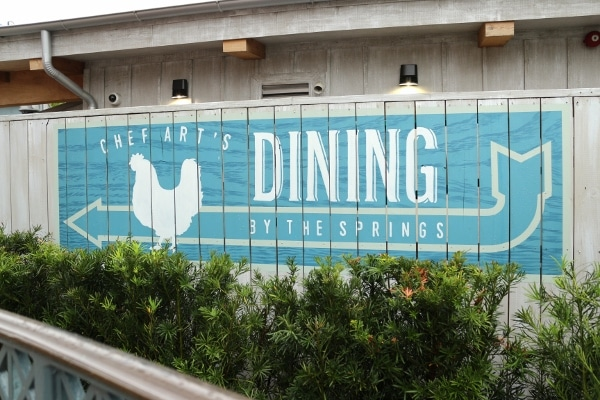 a sign that says Chef Art\'s Dining by the Springs