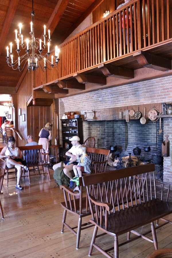 the waiting area inside Liberty Tree Tavern at Disney\'s Magic Kingdom