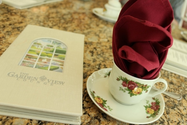 a tea cup and a menu on a table