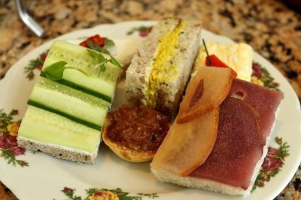 closeup of a plate of tea sandwiches