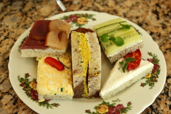 closeup of tea sandwiches on a floral plate