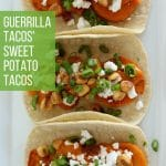 soft tacos with roasted sweet potatoes, feta cheese, corn nuts, and scallions