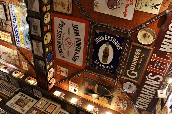 signs on the ceiling of an Irish pub