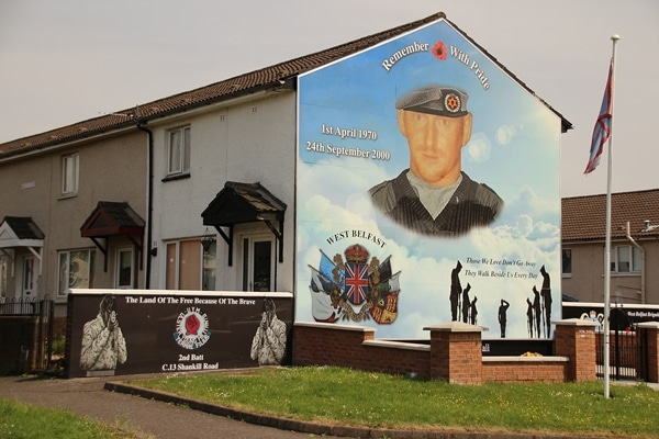 wide view of a mural of a solider on a building
