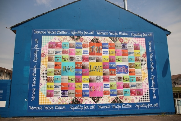 a colorful mural that says Women\'s Voices Matter... Equality for All