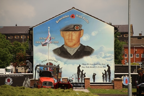 a mural of a soldier on the side of a building