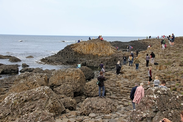 A group of people on a rocky beach