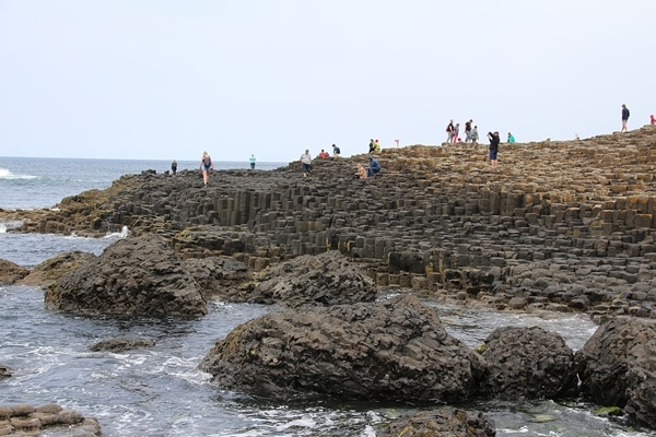 A group of people on a rocky shore