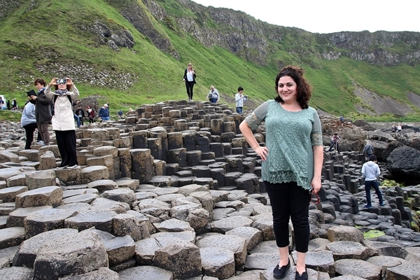 a woman posing on the Giant\'s Causeway in Northern Ireland
