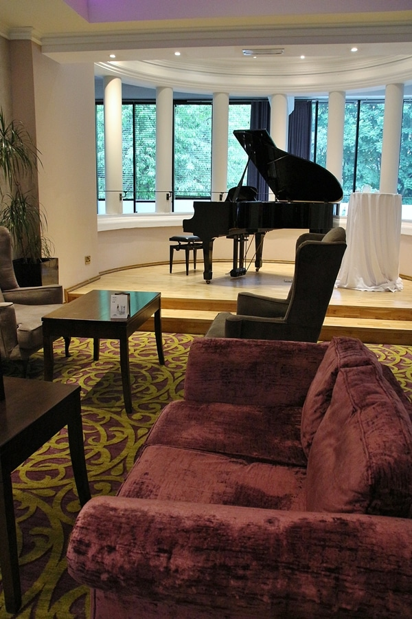 a hotel lounge with a piano
