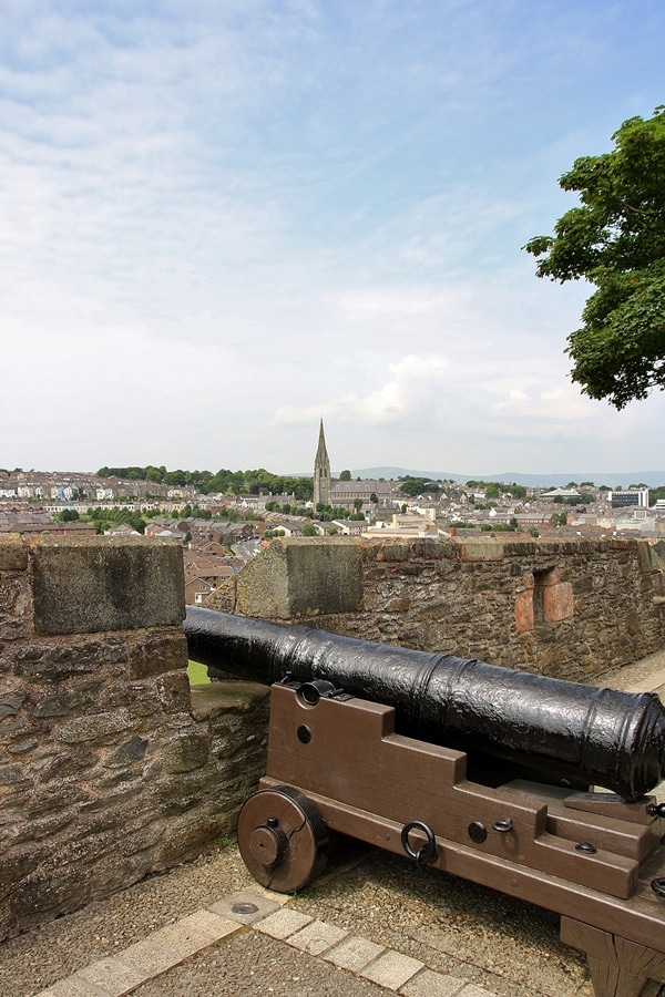 a cannon displayed overlooking a city