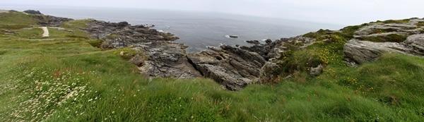 A close up of a rocky hillside along the sea