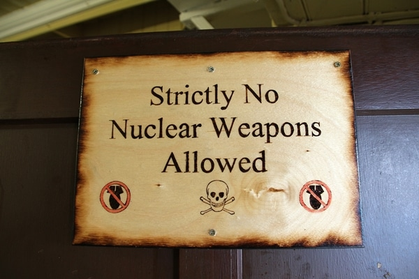 A sign that says Strictly No Nuclear Weapons Allowed