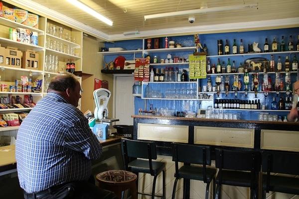 a man sitting at a bar