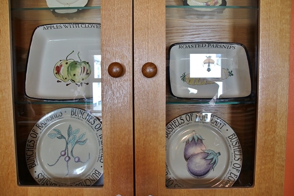 dishes on display in a glass case