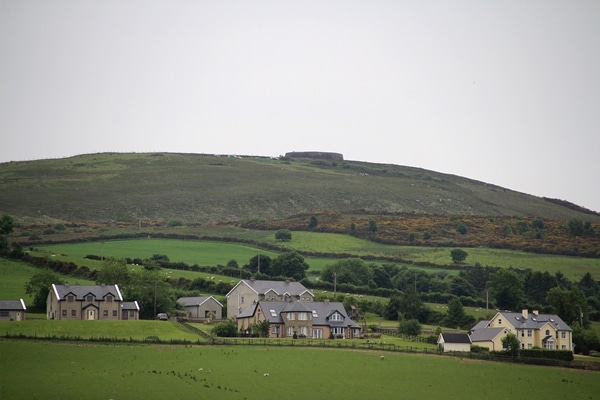 houses surrounded by vast green fields