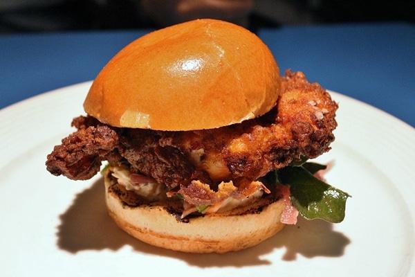 A fried chicken sandwich on a plate