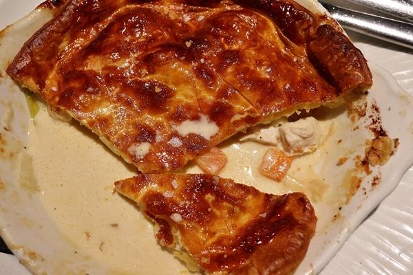 a half eaten chicken and leek pie