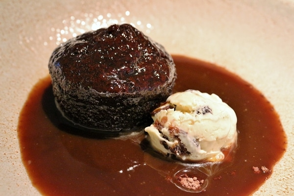 sticky toffee pudding with ice cream on a plate