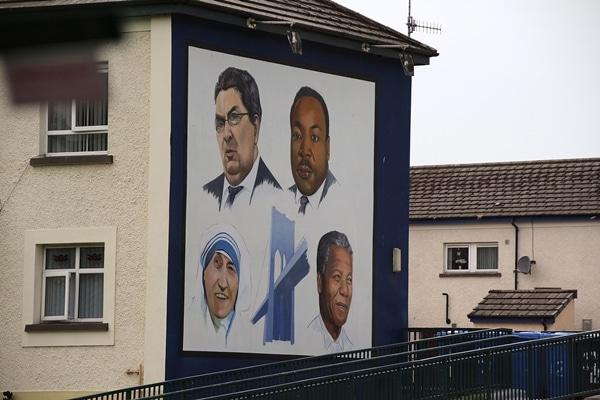 portraits painted on the side of a building
