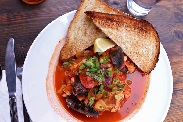 a seafood stew with toasted bread
