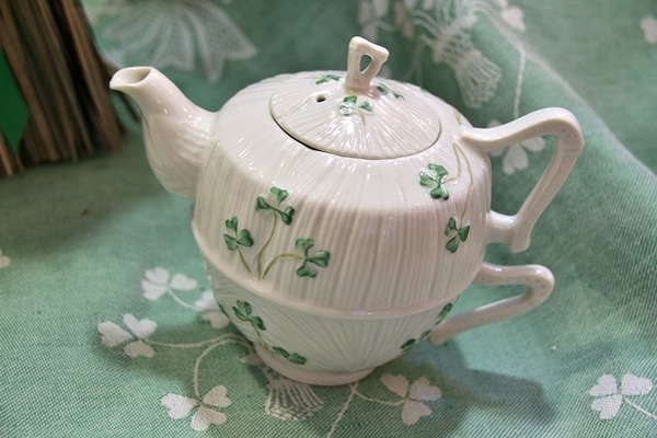 a teapot decorated with shamrocks
