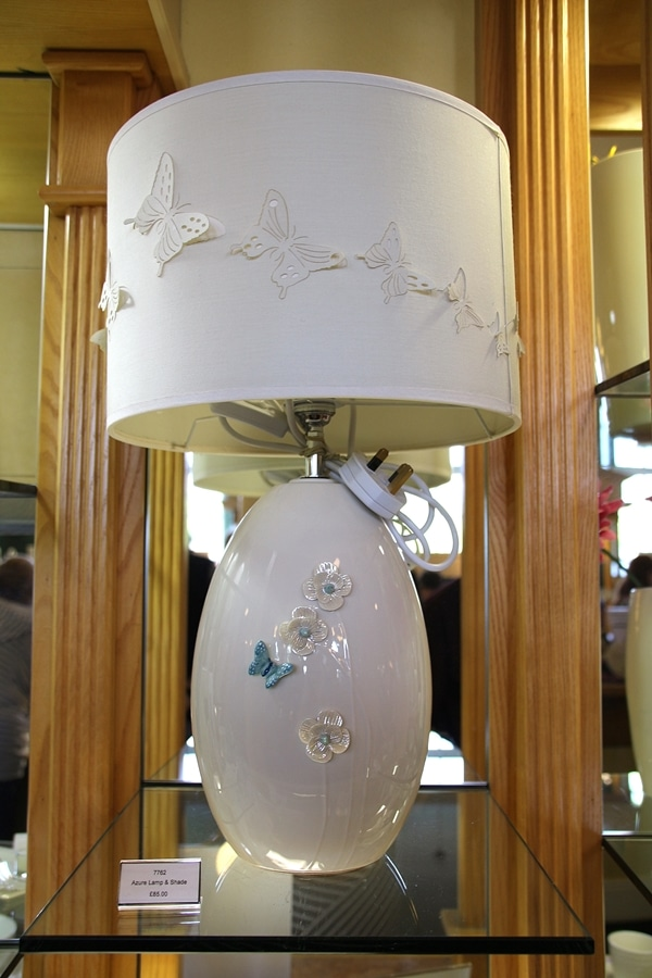a lamp embellished with butterflies