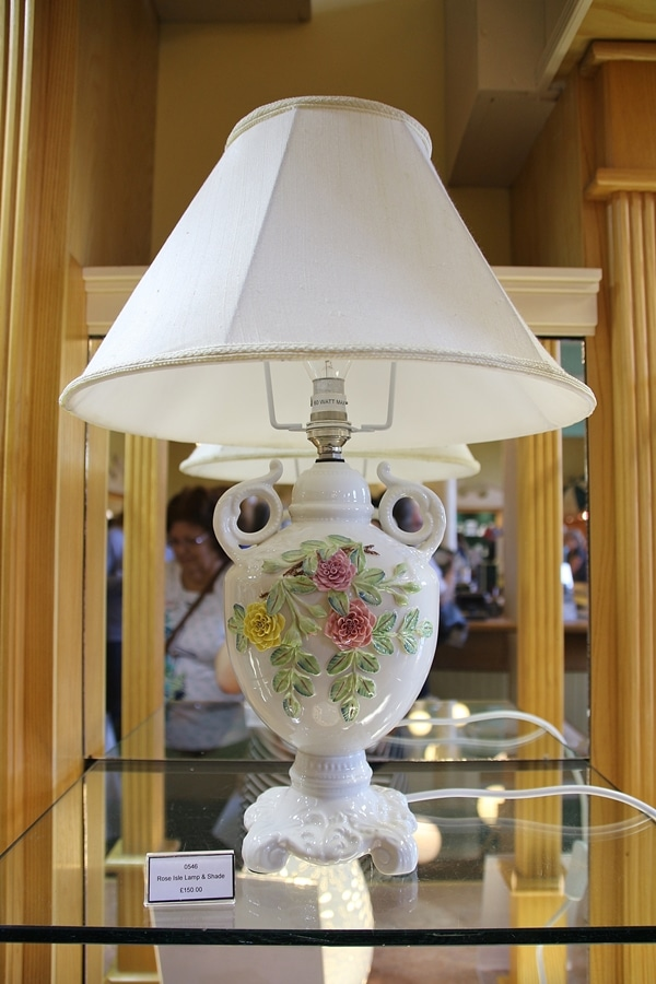 a lamp with flowers on it