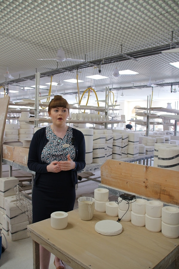 a woman in a pottery factory