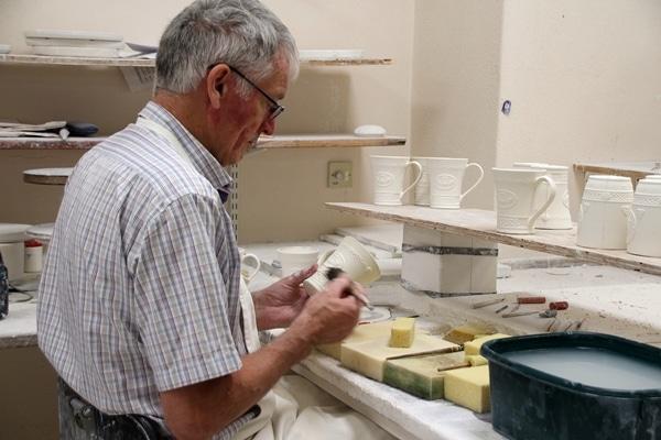 A man making pottery
