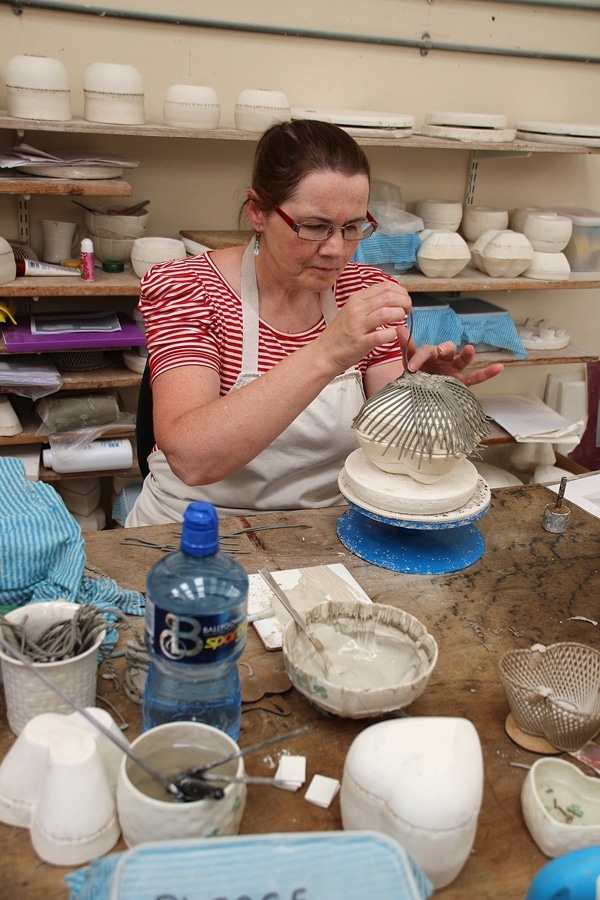 A woman making latticed pottery