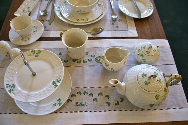 a variety of pottery items decorated with shamrocks
