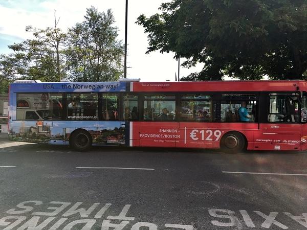 A public transit bus on a city street