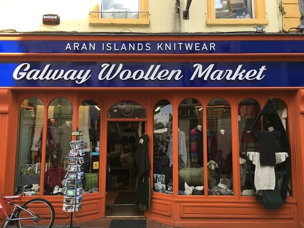 exterior of a store that says Galway Woollen Market