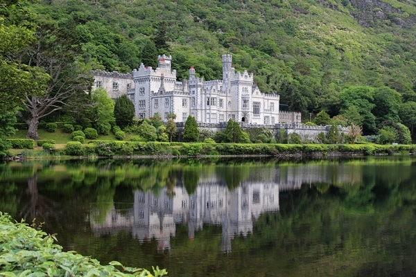 Kylemore Abbey with its reflection in a pond
