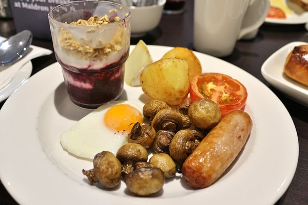 an Irish style breakfast on a white plate