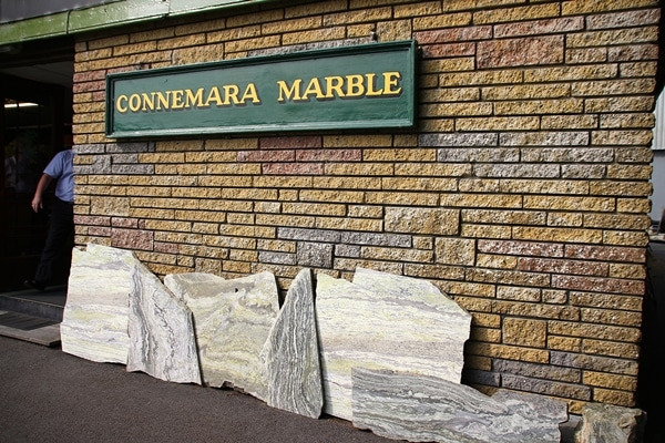 A stone building that has a sign that says Connemara Marble