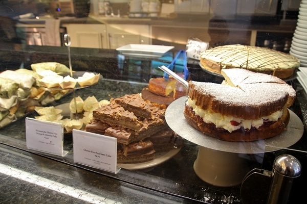 a display of desserts for sale in a cafe