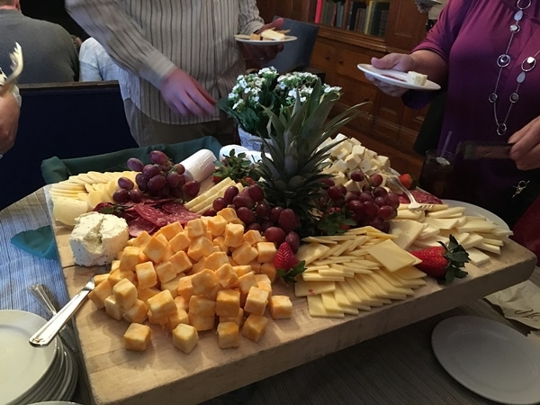 a large cheese and fruit platter